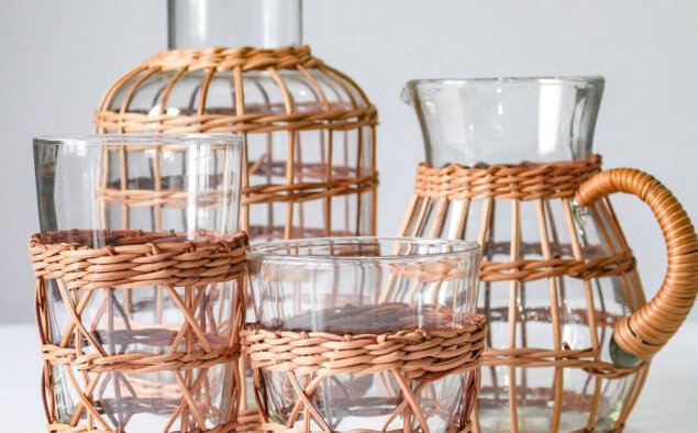 Rattan cage carafe vase with other rattan pieces.