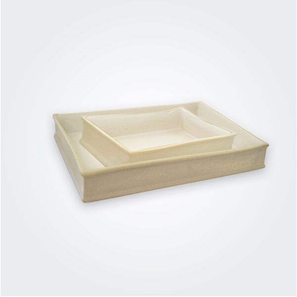 Beige stoneware baking dish set product picture.