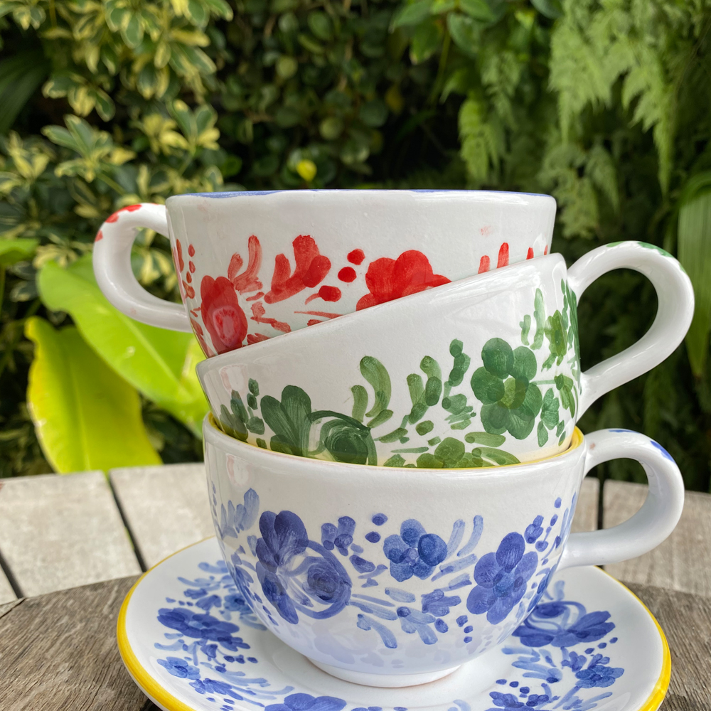 Blue flowers personalized cup and saucer set context picture.
