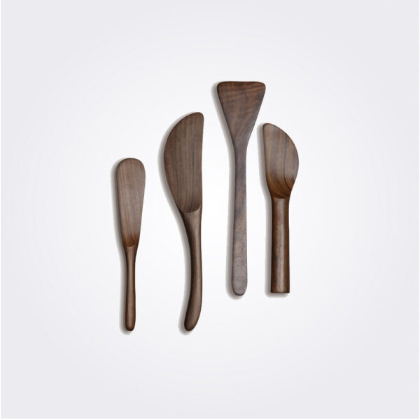 Dark wooden cheese spreaders set product picture.