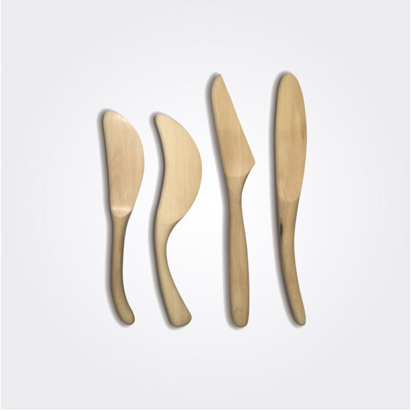 Light wooden cheese spreaders set product picture.
