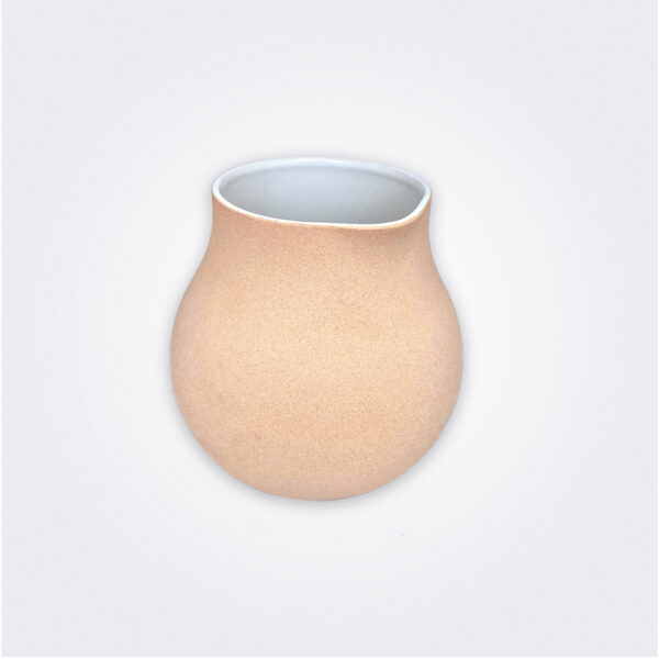 Beige ceramic vessel product picture.