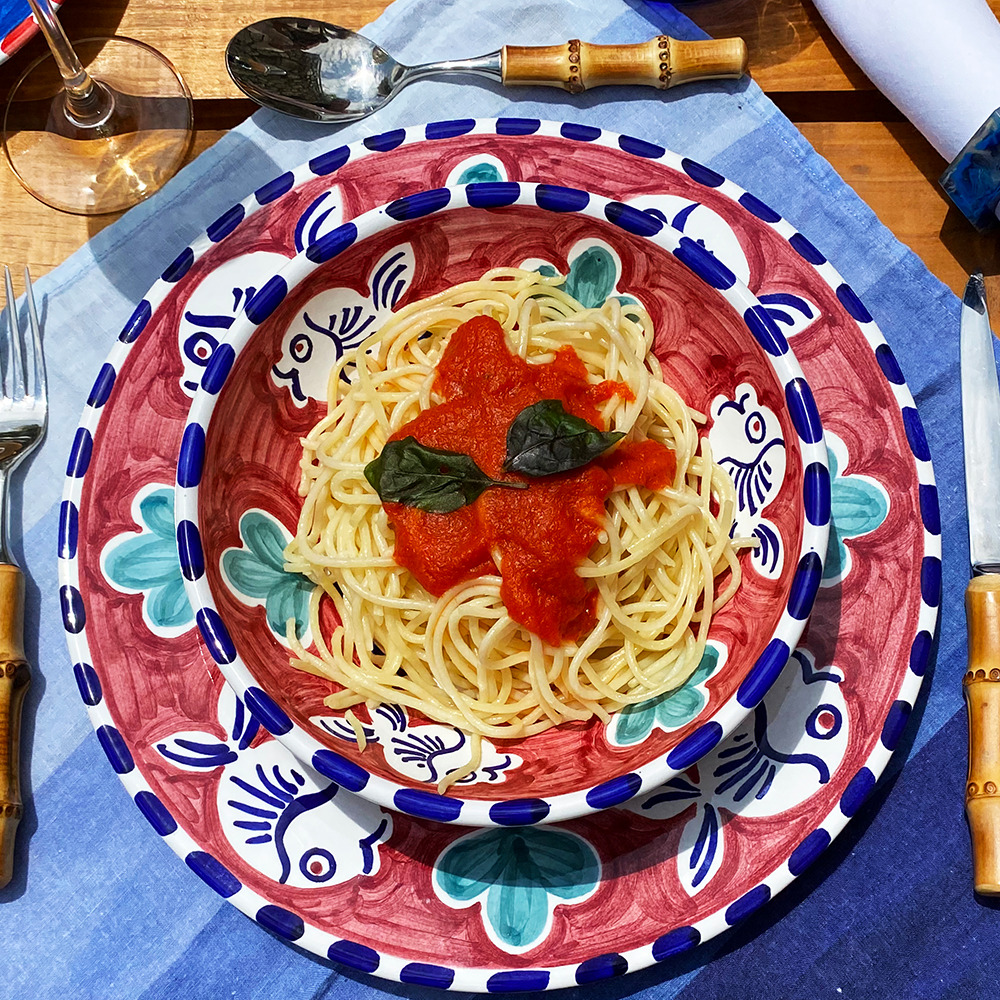 Blue fish ceramic pasta plate context picture