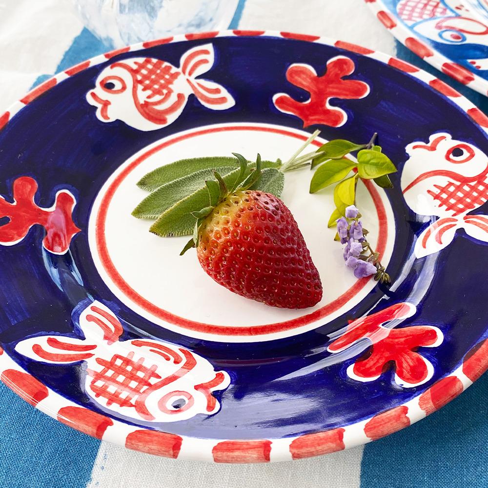 Red fish ceramic salad plate context pixture